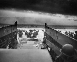Into the Jaws of Death: US Army troops wade ashore on Omaha Beach on the morning of June 6, 1944 / Chief Photographer's Mate (CPHoM) Robert F. Sargent